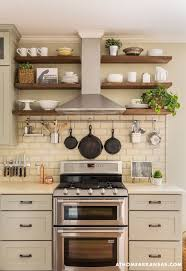 Little Rock Arkansas Home Makeover by Kathryn LeMasters | range hood  incorporated into shelving wall