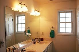 rustic bathroom lighting fixtures. rustic bathroom light fixtures grey ceramic tile beige wall tiled white toilet seat square pale sink modern stainless steel lighting