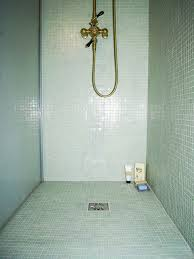 simple walk in showers for small bathroom design with copper shower head and soft colored wall tiles