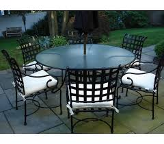 floine 48 inch round dining table with glass top to hold umbrella