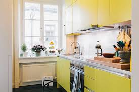 Yellow Kitchen White Cabinets Narrow White And Yellow Kitchen With Cabinets Close Up Stock White