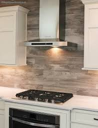 Porcelain Tile Kitchen Backsplash Porcelain Floor Tile With A Gray Woodgrain Pattern Is Installed