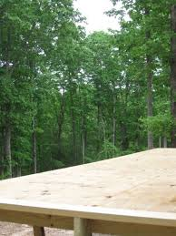 elevated diy low budget deck on uneven slope