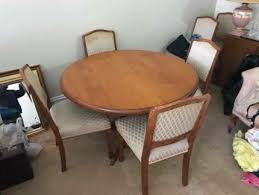 solid timber round dining table