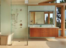 master bath with glass tile wall and sapele wood suspended vanity