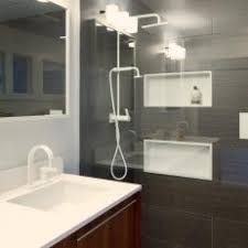 Midcentury Modern Bathroom Features Sleek Shower With Niches