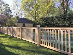 Wood fencing is typically made from cedar, pine or redwood. Wood Fencing In Suffolk County Sunrise Custom Fence