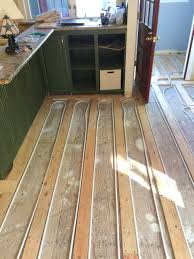 can you install radiant heat under existing wood floors
