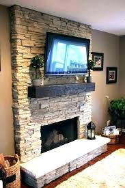 tv above fireplace component storage st
