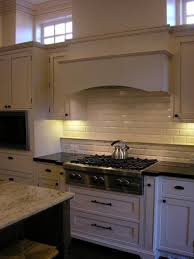 beveled subway tile backsplash