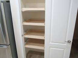 installing pull out shelves inside a pantry closet diy pantry storage shelves