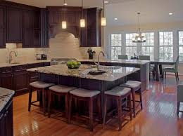 Designing a kitchen island with a lip not only adds surface space for  dining, but