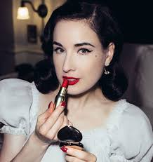 dita von teese shows how to create the perfect red lip look