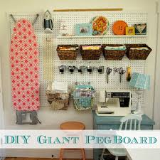 diy how to install a giant pegboard perfect storage idea for a craft room at thehappyhousie