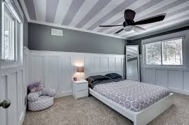 3 tags Contemporary Kids Bedroom with Crown molding, Ceiling fan, interior  wallpaper, Wainscoting, High