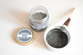 dry mix of diy charcoal mask in a jar with a dark grey charcoal printable label