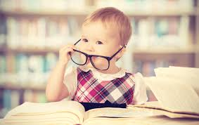 Funny Baby Girl In Glasses Reading A Book Library Favorite Books | The Mom in Me, MD