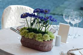 centerpieces with flowers blue plate catering