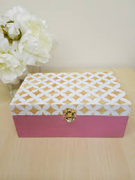 cutting edge stencils shares how to stencil a wooden jewelry box in blush gold and pink