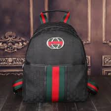 gucci backpack. black gg gucci supreme canvas backpack, a material with low environmental impact, leather trim. backpack