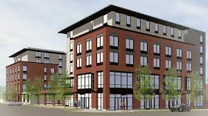 a rendering of a planned six story dual branded hotel on 222