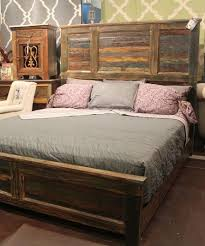 The subtle colors in the reclaimed wood gives this bed tons of personality.