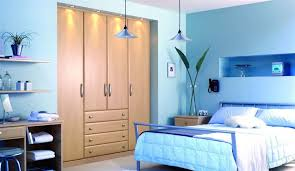 great paint colors for bedroom closets. apartment:blue walls with wooden hidden closet and single bed blue bedding fit great paint colors for bedroom closets