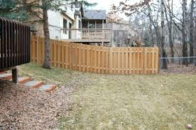building a fence on a slope installing a wood fence how to install privacy fence on