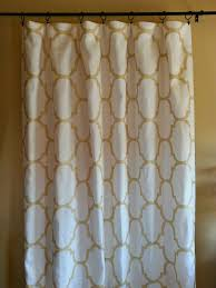 pair of linen curtains in shimmering metallic gold moroccan tile kravet riad fabric curtain panels dries