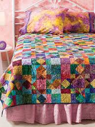Best 25+ Batik quilts ideas on Pinterest | Stained glass quilt ... & Quilting - Use several batik scraps to make a sparkling jewel-tone bed quilt.  This e-pattern was originally published in Lots of Scraps: It's Time to  Quilt. Adamdwight.com