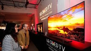 lg wallpaper tv. people watching lg oled tv lg wallpaper tv