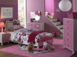 Image of hello kitty toddler bed with storage and bedside shelf