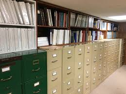 open file cabinet. Donated Family History Books And Local Publications Are Stored Above Some Of The Cabinets. This Open File Cabinet