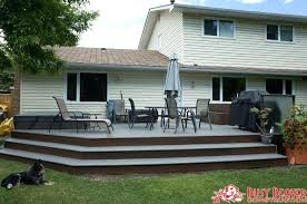 wrap around patio composite deck with wrap around steps and bench seating shrink wrap patio furniture