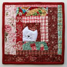 PatchworkPottery: Kitty Potholder pattern & Make a potholder or two, or create an entire quilt using this block. This  is a fantastic way to use up all those fabric scraps. Perfect for all those  cat ... Adamdwight.com