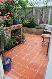 Terracotta Floor Tile Kitchen Square Edge Terracotta Tile Contrasting With Dark Modern Joinery