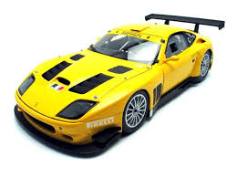 The powered v12 engine produces 605bhp but the max speed is a lot limited by the great aerodynamics. Kyosho Scale 1 18 Ferrari 575 Gtc Evoluzione 2005 Catawiki