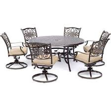 traditions 7 piece aluminum outdoor dining set with 6 swivel rockers with tan cushions and