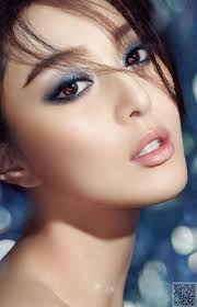 make up with blue eyeshadow play with color for your boudoir session