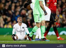 Paris Saint-Germain's Marco Verratti lays injured during the UEFA Champions  League round of 16, first leg match at Old Trafford, Manchester Stock Photo  - Alamy