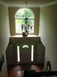 two story foyer lighting unthinkable chandelier height light fixture luxury modern entry interior design 33