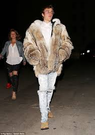 hard to miss justin bieber sported a thick fur coat as he left the shots