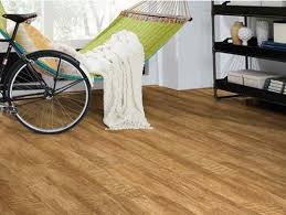 laying vinyl floor tiles on floorboards images
