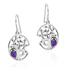 branches of a tree of life in this earring set created in the thai work of khya crafted from polished sterling silver 925 the pendant rests