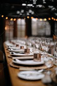 wine glasses and other plates on table ready for a party