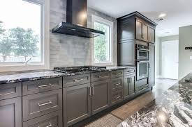 prefab stainless steel countertops elegant black stainless steel kitchenaid rangehood in between windows in a