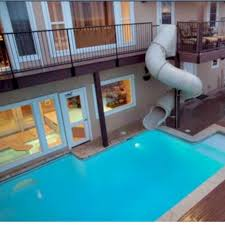 mansion with indoor pool with slides. Interesting Pool 24 Awesome Home Indoor Pool Design With Slide To Make Your Kids Have Fun  SPACES Intended Mansion Slides 1