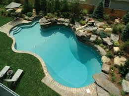 inground pools with diving board and slide. Gorgeous Inground Mountain Oasis Shaped Pools With Landscape Plants Around Swimming Pool Also Brick Paver Coping And Natural Stone Diving Board Slide