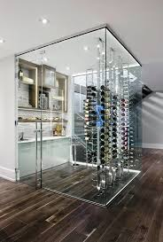 glass to glass locks fix the wine cellar door to the glass panel wall while extra long handles secure the door into the floor