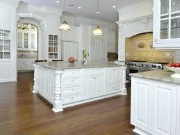 kitchen design traditional. we love the massive island at center of this traditional white kitchen anchoring design
